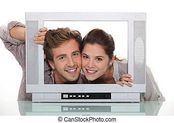 Couple inside a tv screen