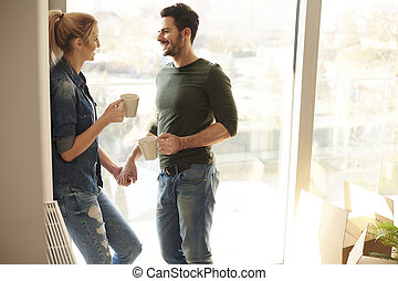 Couple inside new home during coffee break