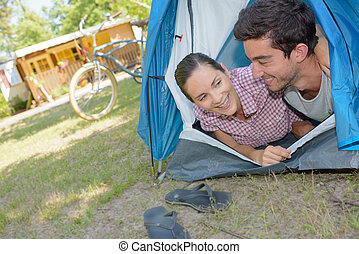 couple inside the tent
