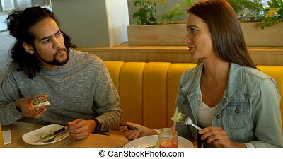 Couple interacting while having food 4k - Couple interacting...