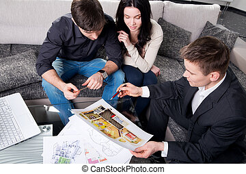 couple is considering future apartment design - couple is...