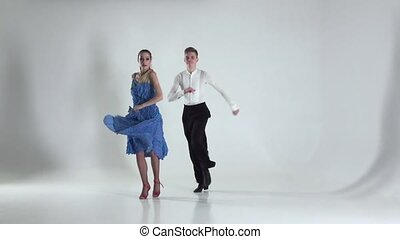 Couple is dancing latino on white background, shadow. Slow motion