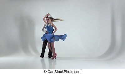 Couple is dancing samba on white background, shadow. Slow motion