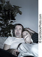 Couple is watching a Movie at home