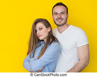 couple isolated on yellow Background