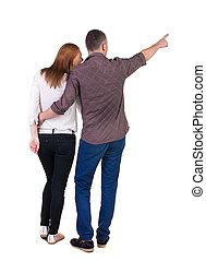 couple, jeune, pointing.