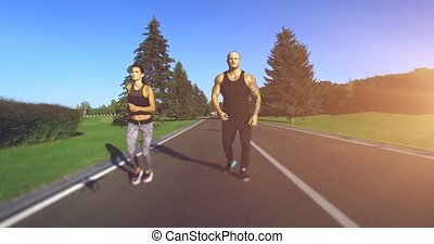 Couple jogging in the park. 4k, 25 fps
