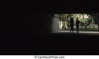 Couple jogging outdoors - Young man and woman jogging...