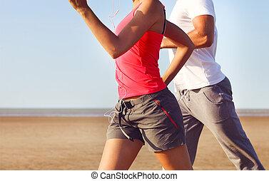 Couple jogging outside. Close up