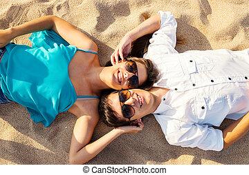 Couple joining heads on beach