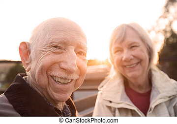 Cute Caucasian couple sitting together outdoors