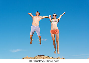 couple jumping together