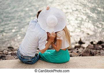 couple kiss on beach together