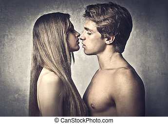 couple kiss - young pair of lovers kissing