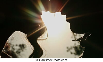 Couple Kisses at Sunset