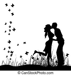 Couple kisses on a meadow, black si