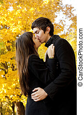 Couple kissing at alley in the park.