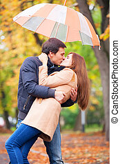 couple kissing at outdoor in the park