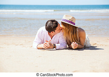 Couple kissing at the beach
