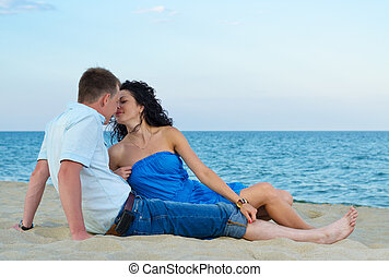 Couple kissing at the seaside