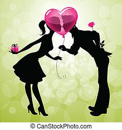 couple kissing behind a balloon