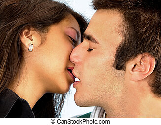 Couple Kissing - Closeup of a young woman and man kissing