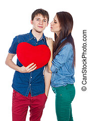 couple kissing holding a red heart