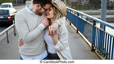 Couple kissing in city during sunset