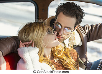 couple kissing in the car