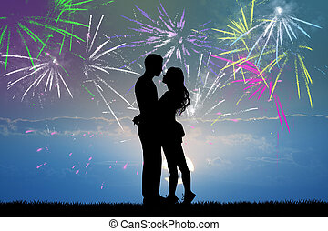 couple kissing in the fireworks