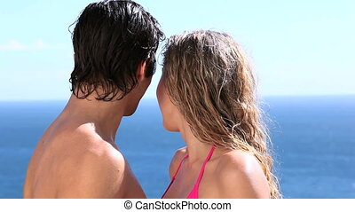 Couple kissing next to the sea