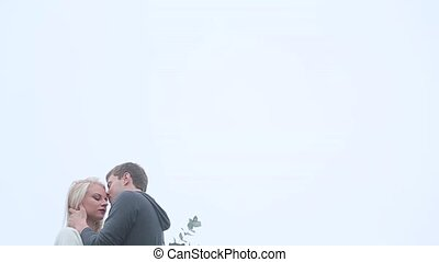 Couple kissing on the roof