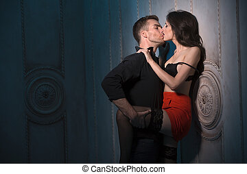 Couple kissing passionately. Man Woman pinned against the...