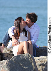 Couple kissing with love beside the sea