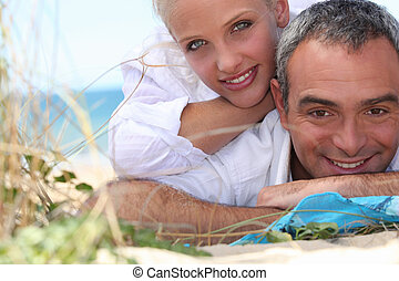 Couple, laid down at the beach