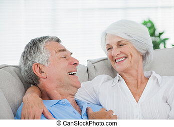 Couple laughing and chatting on a c