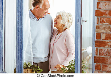 Couple laughing by the window