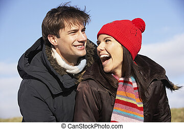 Couple Laughing In The Park Together