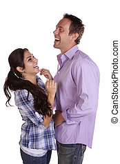 Couple laughing standing