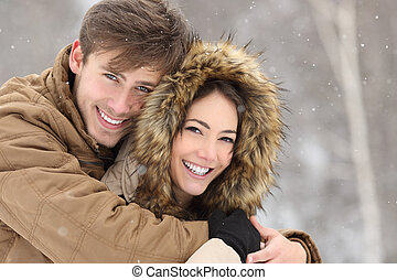 Couple laughing with a perfect smile and white teeth