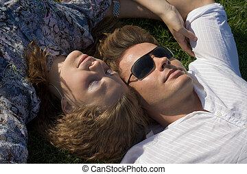 Couple Laying Head To Head