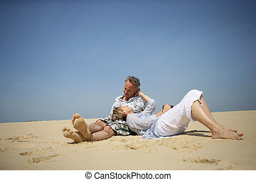 Couple laying in the sand