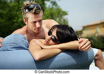 Couple laying in their garden