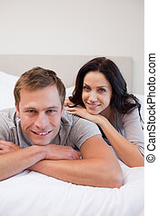 Couple laying on the bed together