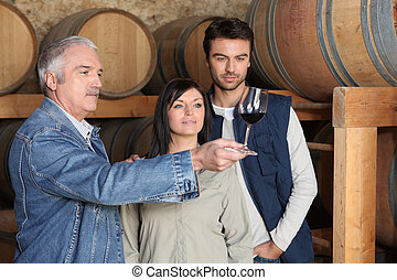 Couple learning how to taste wine