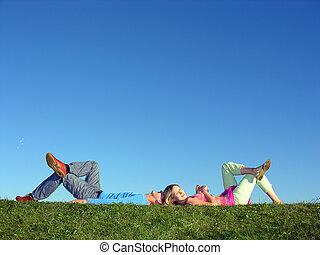 couple lie on blue s