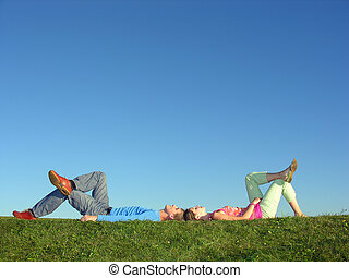 couple lie on blue sky girl look at you