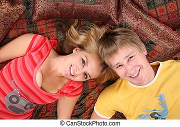 couple lie on carpet