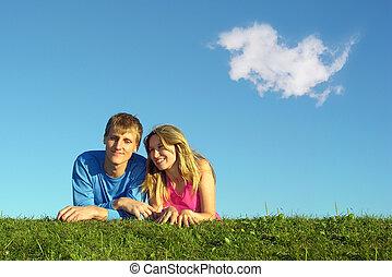 couple lies on meado