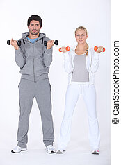 Couple lifting weights